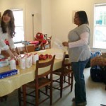 Volunteers organize food for Carrboro children