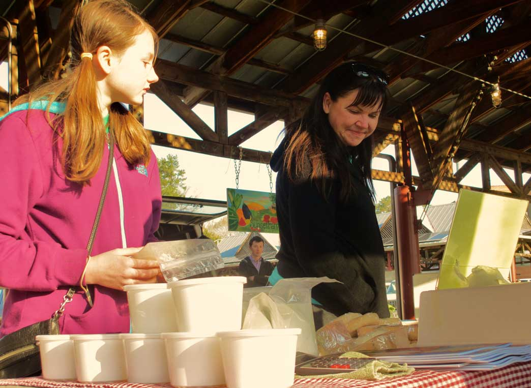 Jeri Ann Guth and her daughter, Zoe browse the market's bread selection on Saturday morning. Guth, a Hillsborough resident, said she tries to support the local food industry as much as she can.