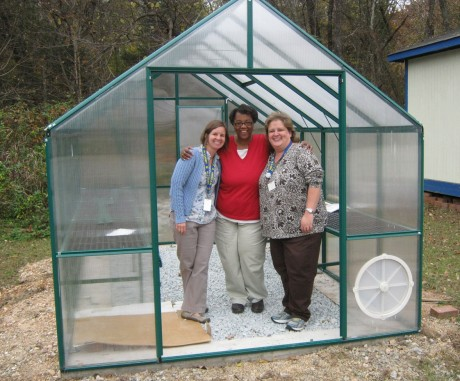 Jennifer Carson (left), Sucovis Hester (center) and Kim Daniel (right) plan to have the greenhouse fully installed by mid-winter. Once the doors are added, teachers will be able to use the greenhouse to incorporate science and agriculture projects into the curriculum.