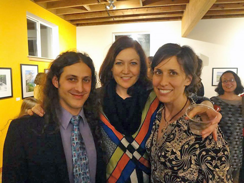 Artist Anna Troupe, center, is joined by friends at her opening in January. (Photo courtesy of Anna Troupe)