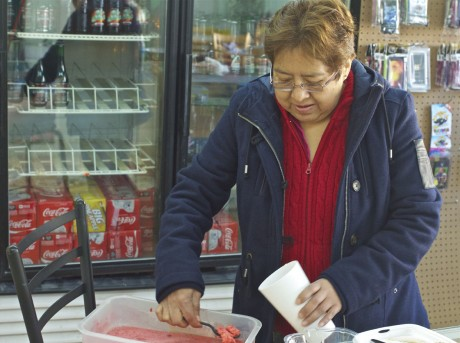 Gloria Gonzalez scoops out homemade sorbet at the new location of Don Jose Tienda Mexicana on South Merritt Mill Road in Chapel Hill.