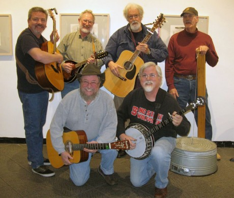 Musicians show off their instruments after the Bluegrass Jam on Monday. John Eichhorn (top right) made a string bass out of a washtub, single string and a lever. (Staff photo by Jessica Milbern)