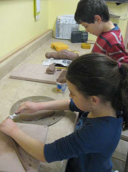Ceramics students Eva and Ramsey work on making critters during a Friday afternoon class.