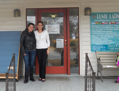 Carrboro Office Coordinator Natalia Lenis (left) and President Pilar Rocha-Goldberg (right) stand on the porch of the El Centro Hispano offices at the new Weaver St location. (Staff photo by Sarah Woronoff)