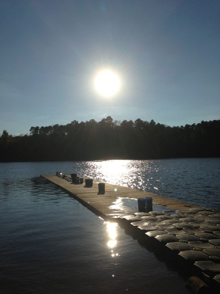 The rowers enter their boats into University Lake with the help of this 80-foot wooden dock.