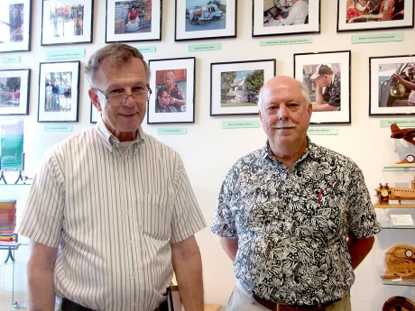 Dave Otto (left) and Richard Ellington (right), combine life experiences and photography to co-author a book on recent Carrboro history.