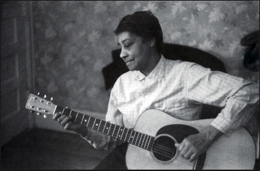 "Elizabeth ""Libba"" Cotten grew up on Lloyd Street and rose from 75-cents-per-month domestic servitude to champion the folk revival of the 1960s. Cotten, pictured here in Washington, D.C., in 1960, won a Grammy Award in 1985 and continued performing into her 90s before she died in 1987 (Photo by John Cohen via The Smithsonian Institution)."