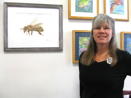 """I love bees, and I love sharing this,"" Dale Morgan says. She uses her paintings as a platform for telling people about the declining population of bees. (Staff photo by Liz Tablazon)"