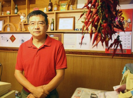 Owner David Yu behind the counter