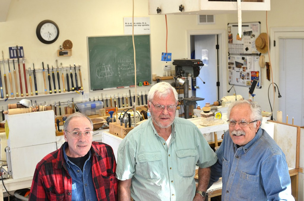 From L-R, Carmine Prioli, Cecil Sparrow and Frank Penta show off Wood Sprite Turnings, the studio that houses the Chapel Hill Woodturners.