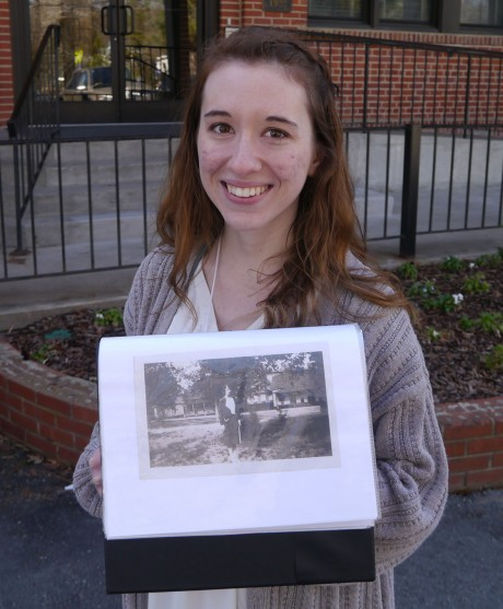 Victoria Hensley leads the Carrboro walking tour, which starts at the Carrboro Town Hall. She shows historic photos that offer contrasts between now and then, saying that one of the best ways to get to know Carrboro is take the tour. (Staff photo by Sophie Wu)