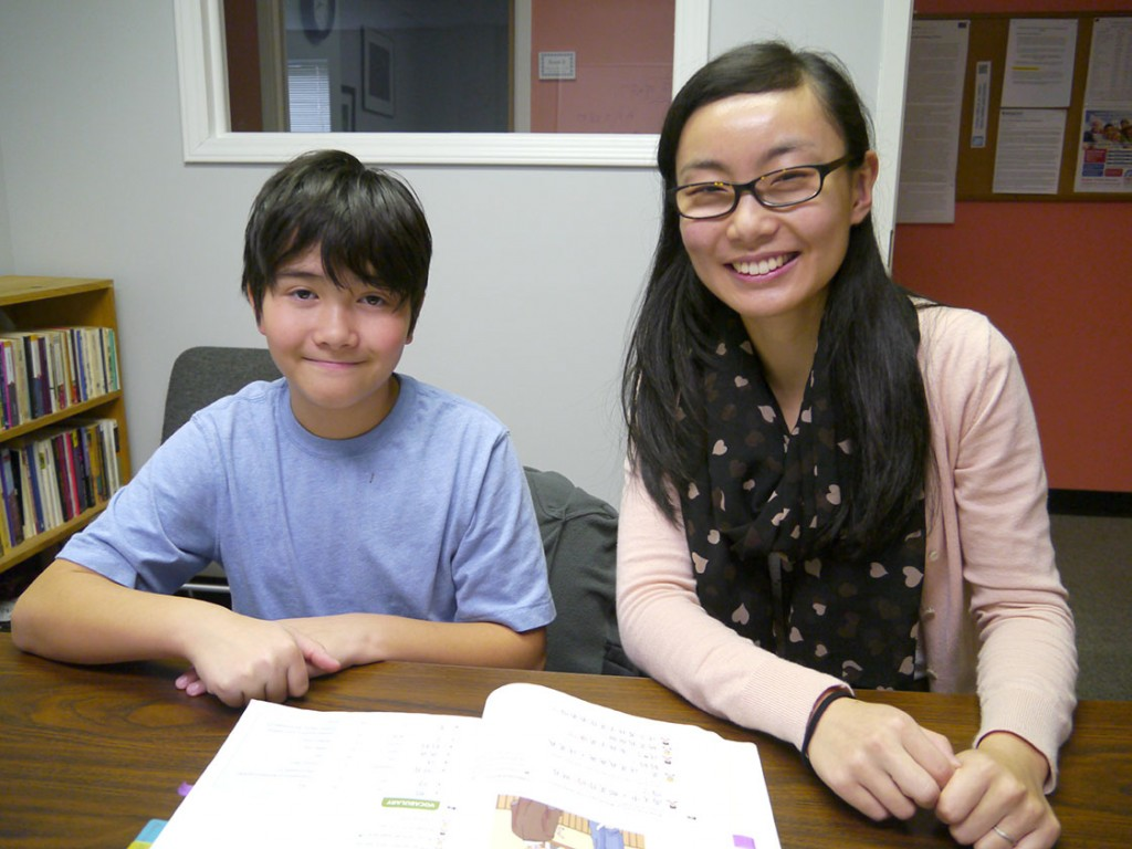 Zach Fong (left) and Tianlu Redmon meet for Mandarin class at CHICLE on Sunday afternoons. Before class, Zach would study the vocabulary, listen to the dialogues online, read them out loud and memorize them. (Staff photo by Sophie Wu)