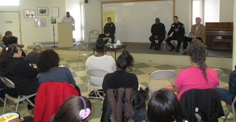 "The ""Know Your Rights"" panel discusses citizen concerns about law enforcement during Saturday's event held at Hargraves Community Center on 216 N. Roberson St. in Chapel Hill. Moderated by Dr. Rodney Coleman (left), the panel consisted of (left to right) Capt. Chris Atack of the Carrboro Police Department, Orange County Public Defender James Williams, Patrolman Nathan Downs of the Chapel Hill Police Department and Orange County District Court Judge Jay Bryan."