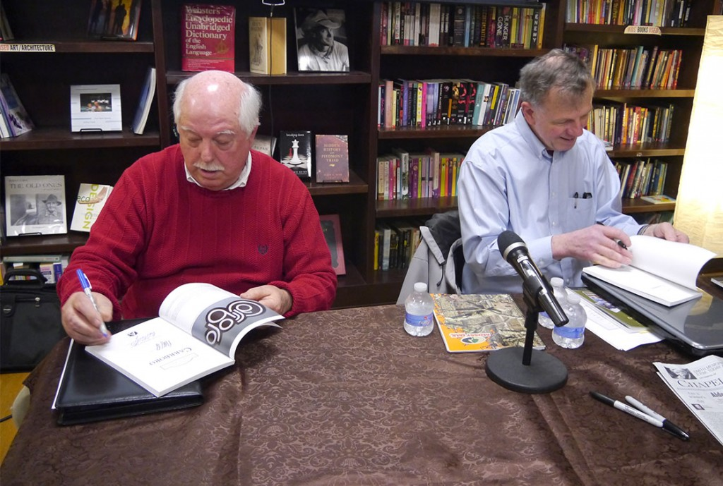 Richard Ellington (left) and Dave Otto sign books for their readers at Flyleaf Books. (Staff photo by Sophie Wu)