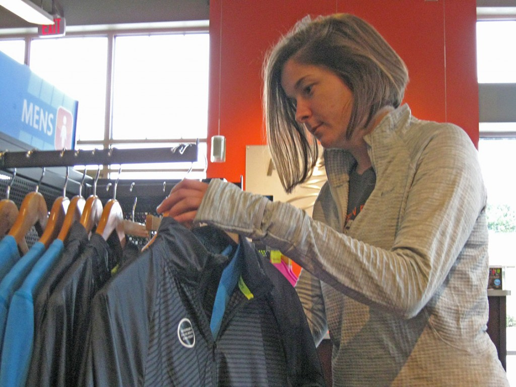Sales associate Nicole Mogensen checks the jacket sizes at Fleet Feet. Carrboro's Fleet Feet – which sells apparel for runners – has been in the town for over 20 years and has been home to the company's headquarters for nearly 13 years. (Staff photo by Ben Coley)