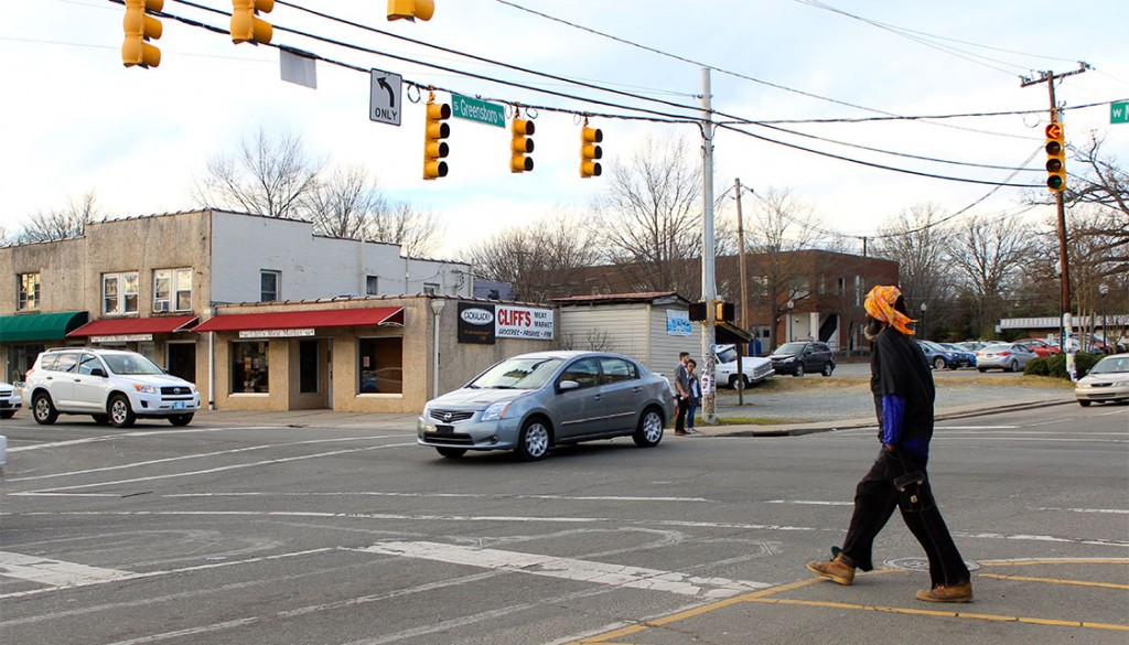 Pedestrians find it dangerous to cross the busy streets and intersections of Carrboro, like the intersection of S Greensboro and W Main Street. The Transportation Advisory Board is responding to resident complaints and working to improve pedestrian safety in Carrboro by implementing more crosswalks. (Staff photo by Kelley Hamill)