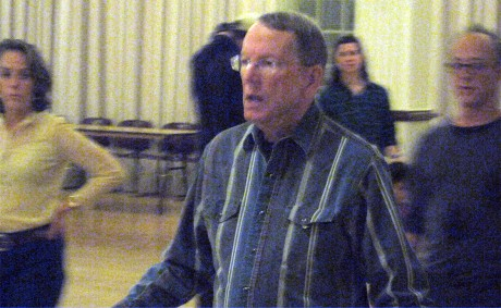 Instructor Bruce Gillooly (center) teaches a group of students how to line dance during the Dance Jam on Friday night. Gillooly said afterwards that his least favorite dance to teach is the Electric Slide because he has taught it so many times, so he has made some personal adjustments to teaching the dance.